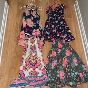 Bundle of 4 flower power dresses. Carters size 4.